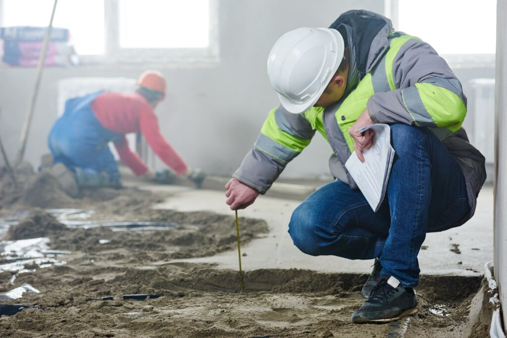 A construction consultant analyzing a construction site.